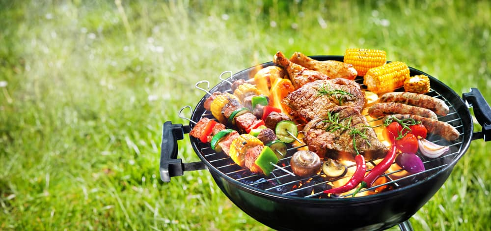 Delicious grilled meat with vegetables on barbecue grill